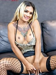 Busty ladyboy Thanya is taking off her clothes to get naked and she will rock her cock until she cums!